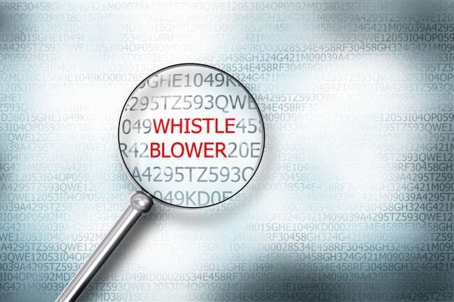 "magnifying glass over word ""whistleblower"""