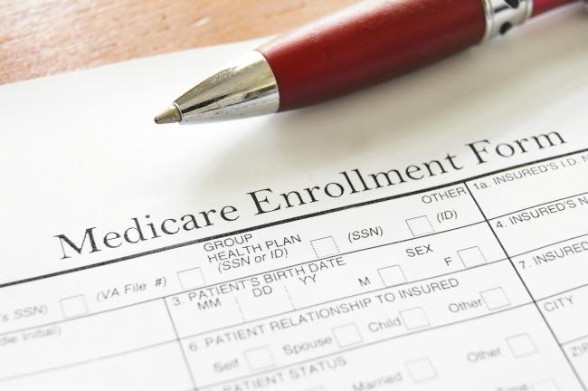 Medicare enrollment form and pen