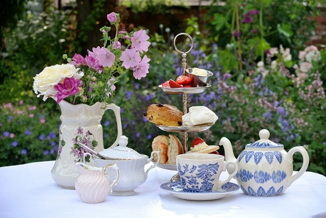 An afternoon tea service in a garden