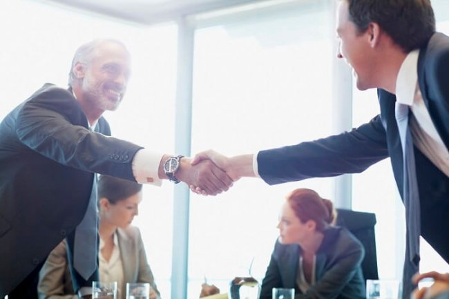 Business executives shaking hands
