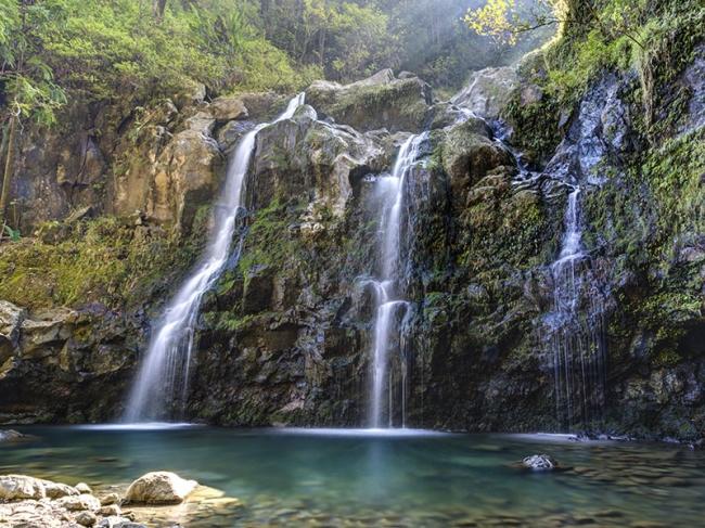 Tripple Waterfall called Upper Waikuni Falls or Three Bear Falls of the Wailua Nui Stream along the Road to Hana on Maui Island in Hawaii.