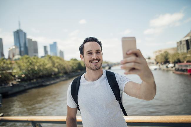 young man millennial taking selfie