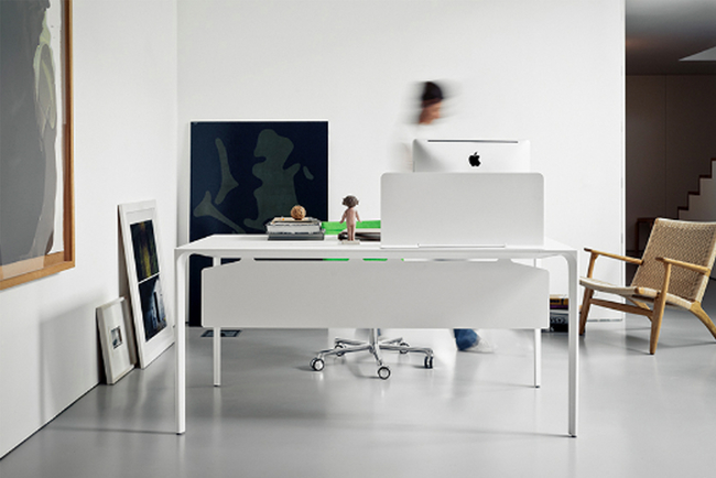 Designed by Simon Penally, Nuuk is said to be the archetypal table, with a single, spare plane floating above four slender legs.