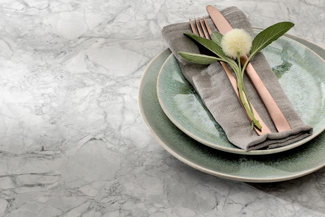 """The collection of nine designs was developed over the last two years and features """"cracked ice"""" patterns in light icy blues, dark blues, and shades of gray, white and black."""