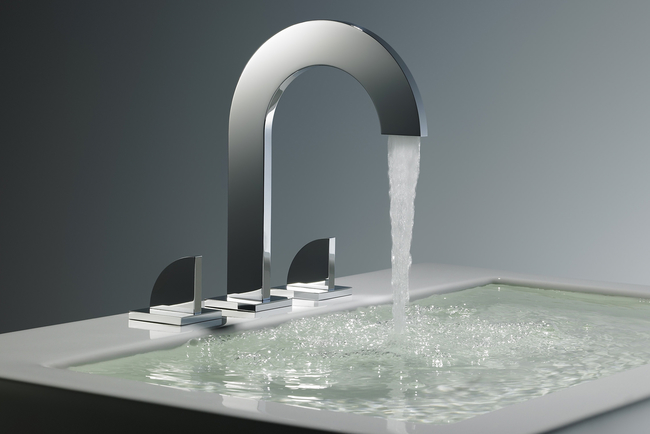 Edge has a rounded arc tempered by the masculine sharpness of the faucet's corners.