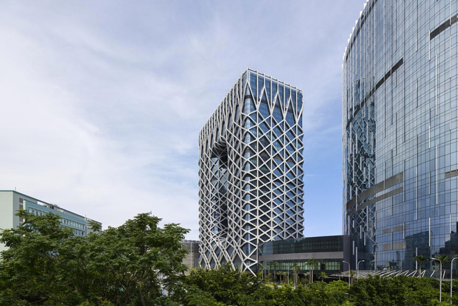 Zaha Hadid Architects completes Morpheus Hotel as world's first free-form high-rise exoskeleton.
